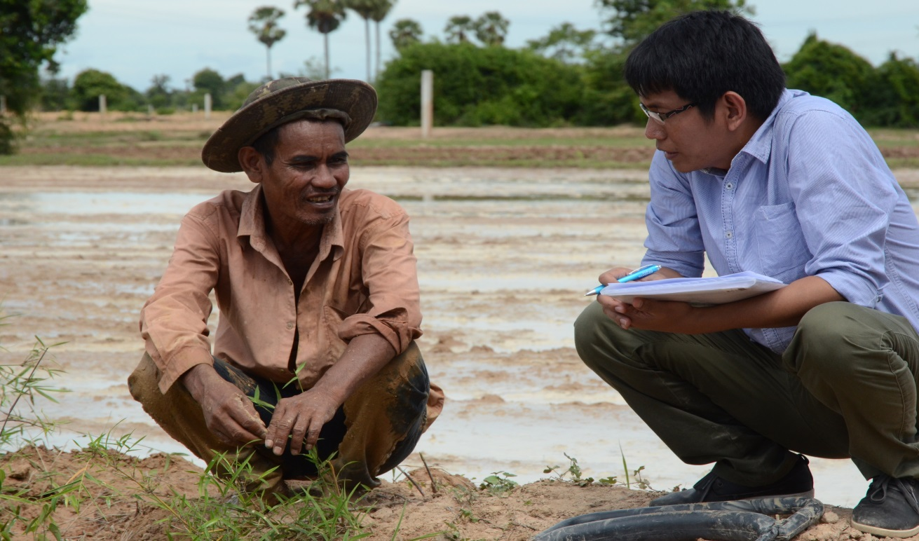 interviewing farmer by river cambodia