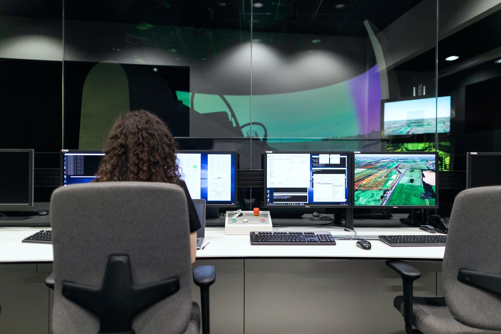 Female aerospace engineer monitors flight simulator